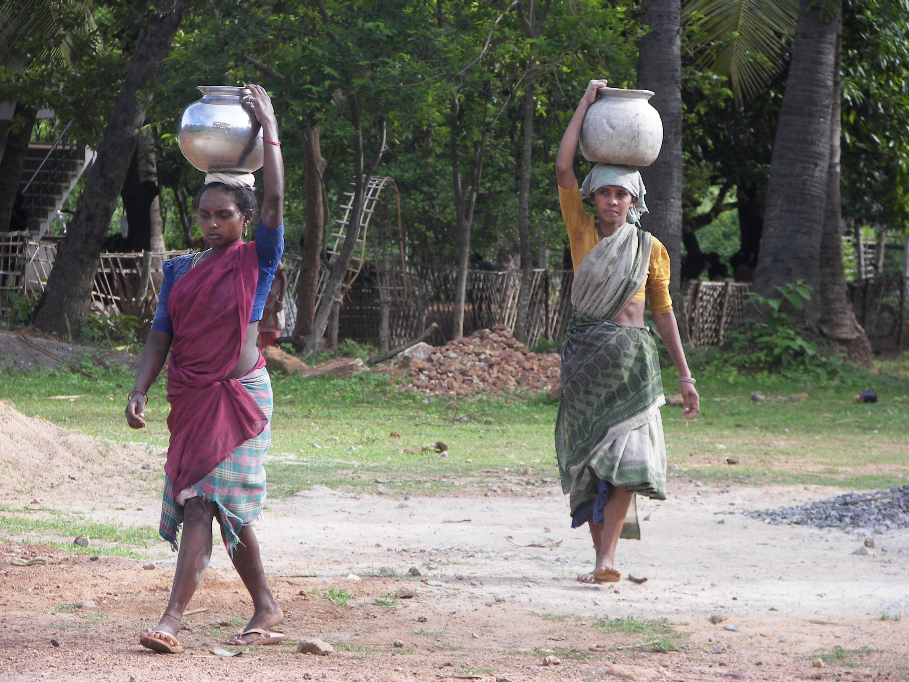Wome carrying water 2